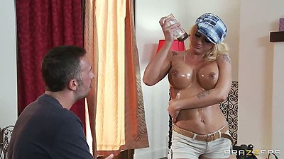 Athletic Leya Falcon oils up her big tits and titty fuck